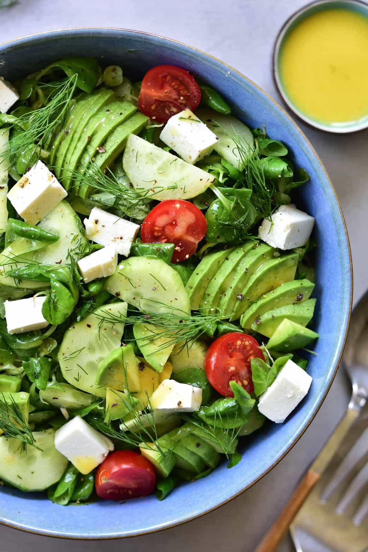 close up shot on cucumber avocado tomato salad