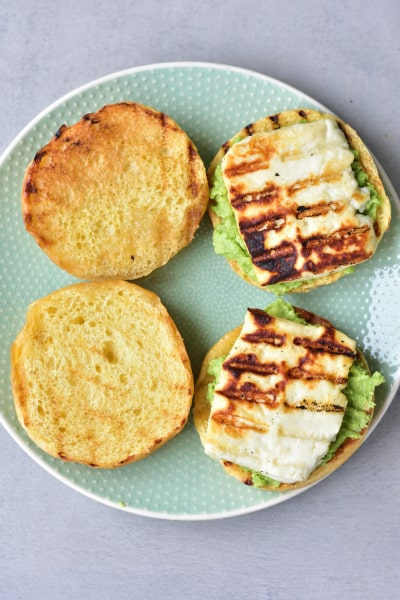 hamburger brioche buns with smashed avocado and grilled halloumi cheese