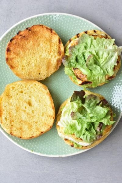 grilled halloumi, pineapple, smashed avocado and salad on hamburger buns