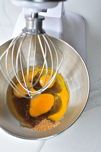 eggs and sugar in a stand mixer bowl