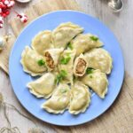 sauerkraut and mushroom pierogi on a blue plate