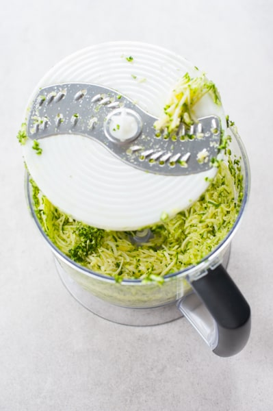 grated zucchini in a food processor bowl