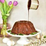 chocolate orange bundt cake on a white cake stand