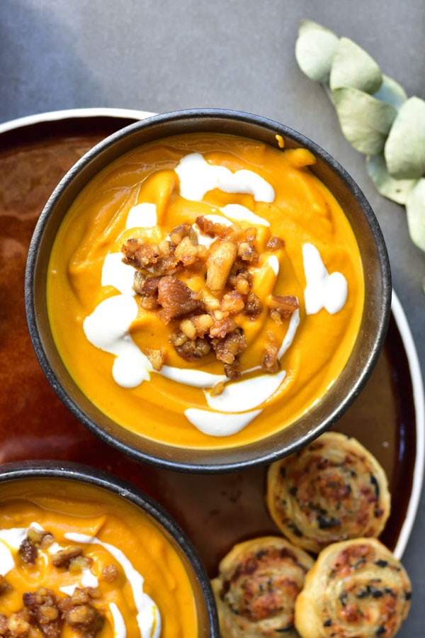 Close up on pumpkin, ginger and brown butter soup with caramelized chestnuts