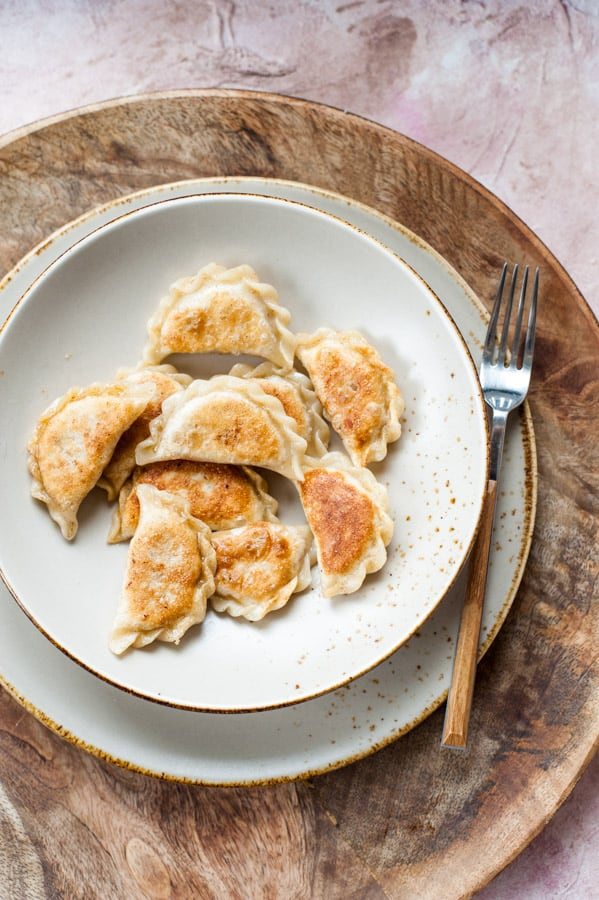 Vegan pierogi with spicy red lentil and sun-dried tomato filling on a plate