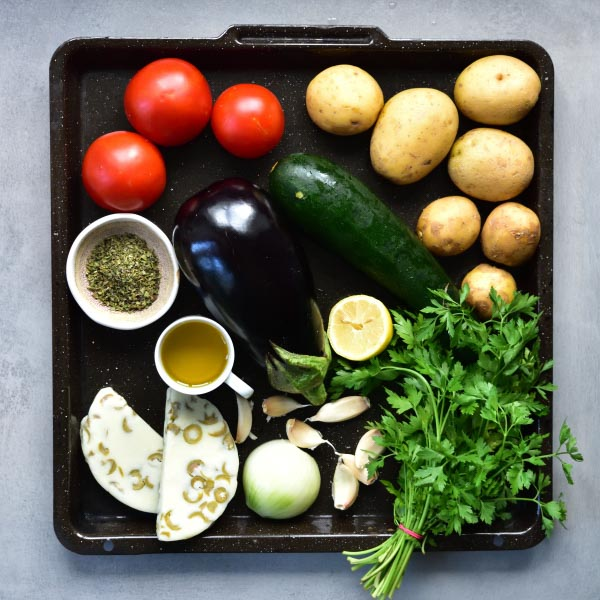 all the vegetables needed to prepare briami on a black tray