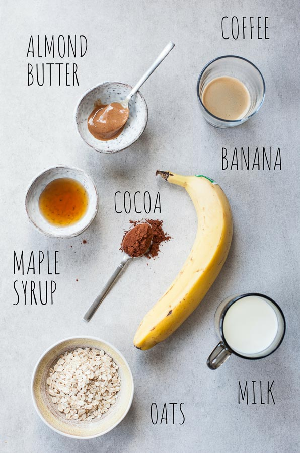 Labeled ingredients for coffee banana smoothie on a table.