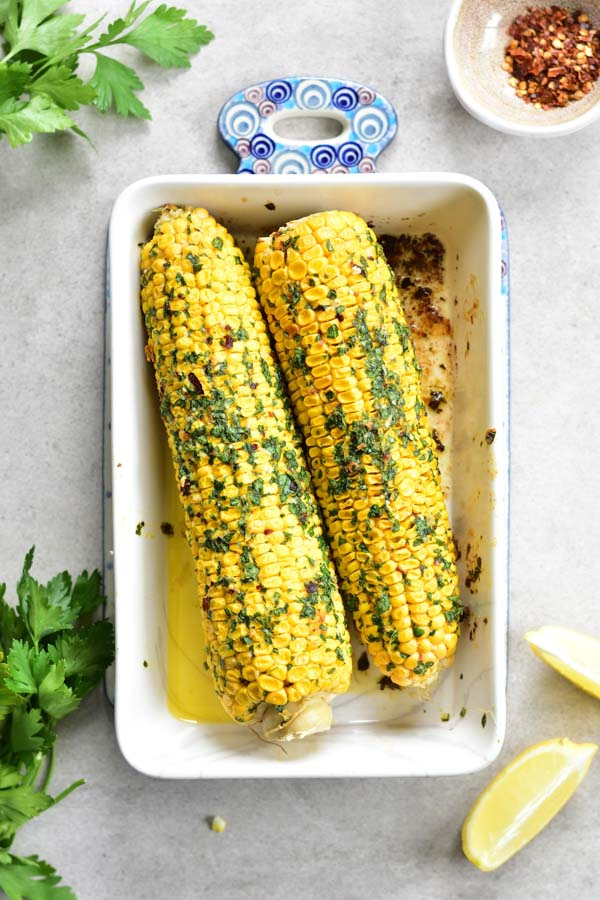 Oven-roasted corn on the cob with herb chili butter