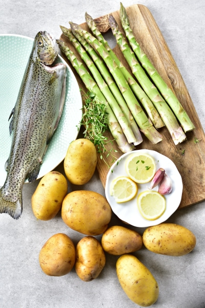 Ingredients needed to prepare whole roasted trout one sheet pan dinner
