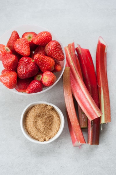 ingredients for the galette filling: strawberries, rhubarb and sugar