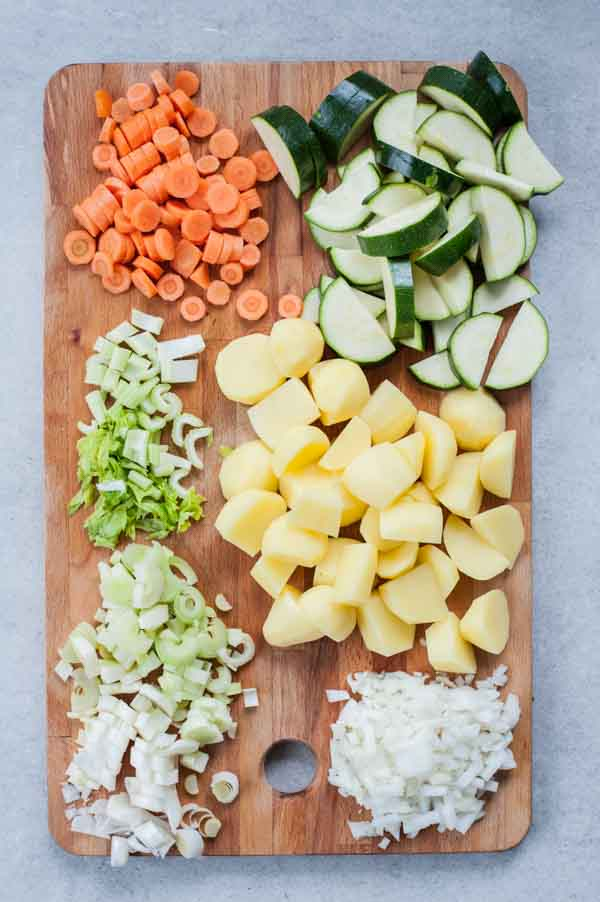 chopped vegetables for pistou soup on a chopping board