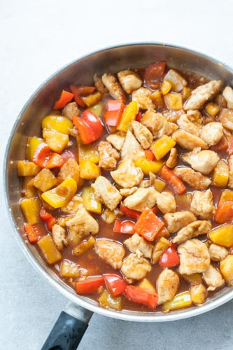 sweet and sour chicken with pineapple on a pan