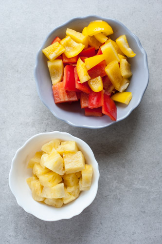 chopped pineapple and bell paprika in a bowl