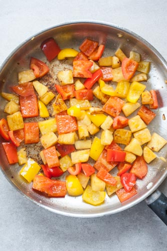 browned pineapple and bell paprika on a pan