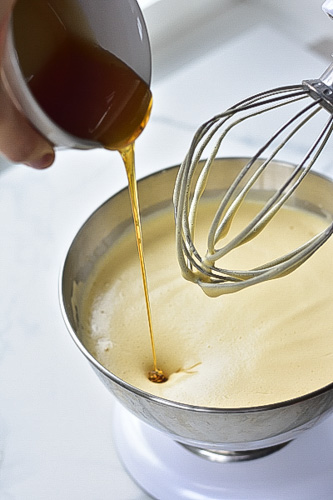 honey-vanilla extract mixture is being added to the batter