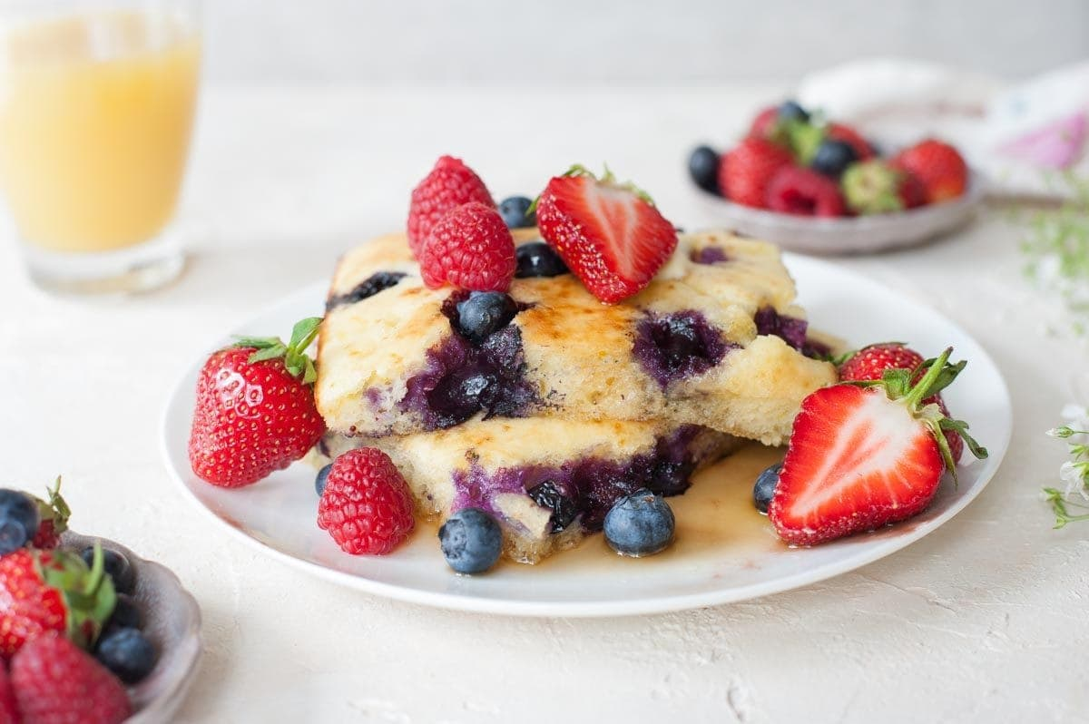 lemon blueberry sheet pan pancakes on a plate