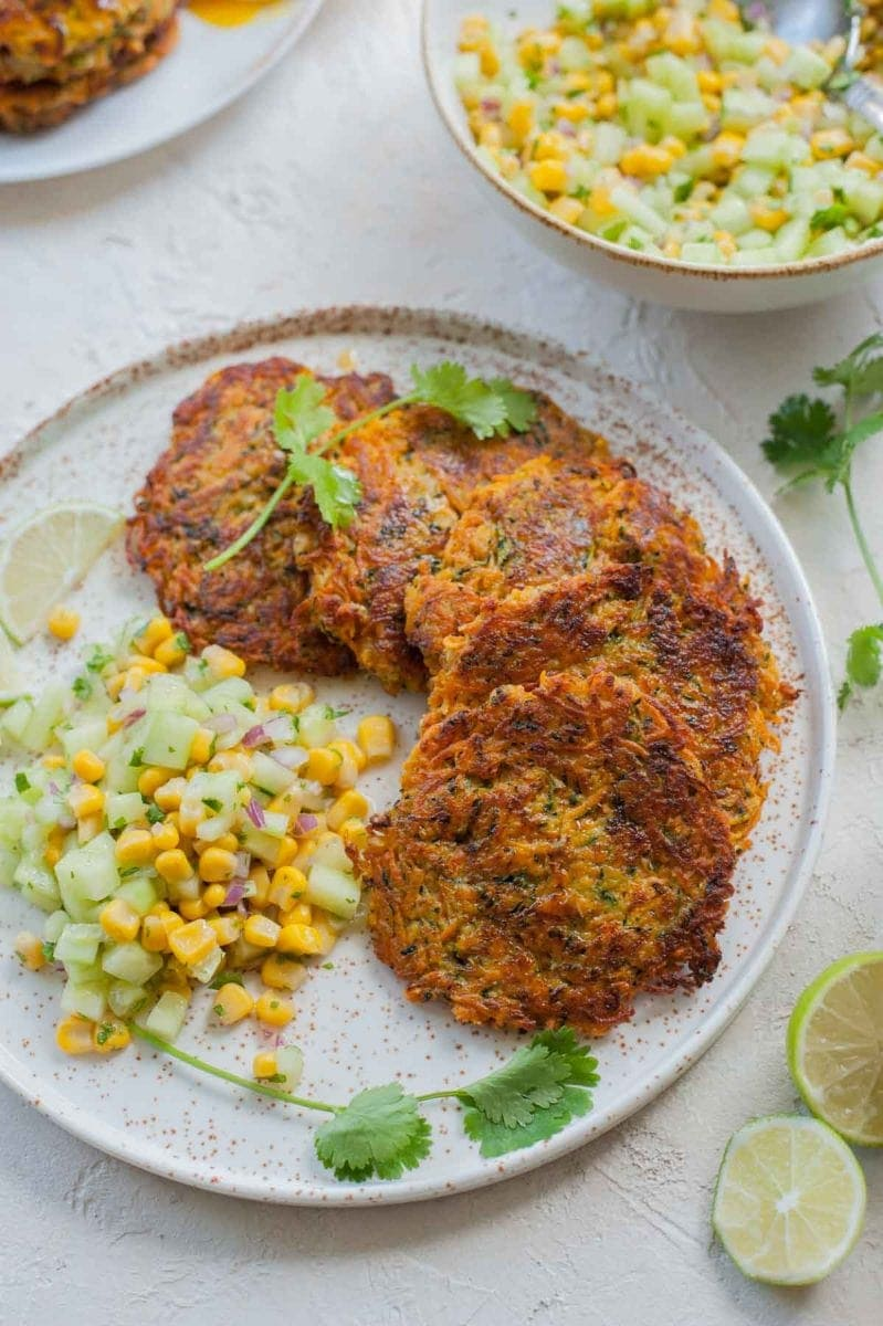 sweet potato and zucchini fritters with cucumber corn salsa viewed from above
