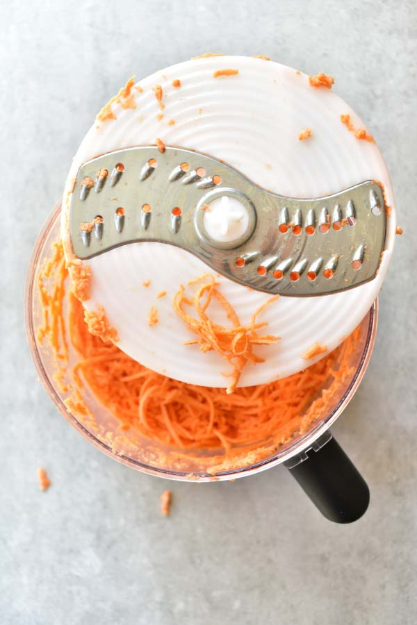 grated sweet potato in a food processor bowl