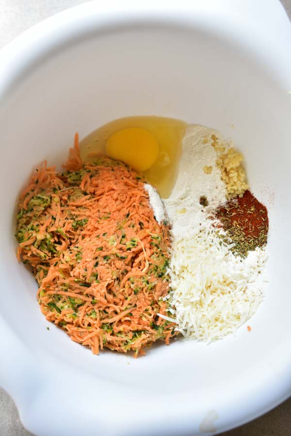prepared fritter ingredients in a white bowl