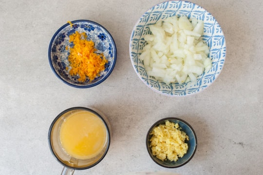 chopped onion, grated ginger and orange zest, orange juice in small bowls