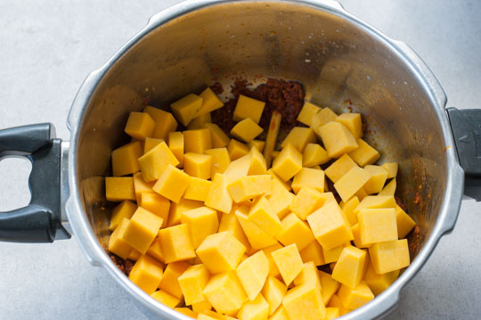 cubed pumpkin in a pot