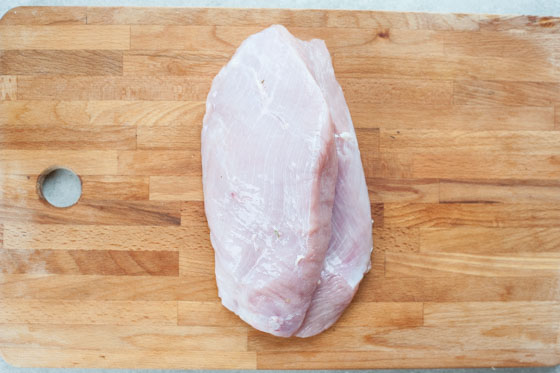 turkey breast on a chopping board