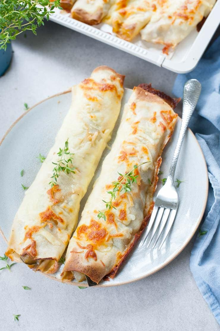 Cheesy vegetable crepes on a blue plate