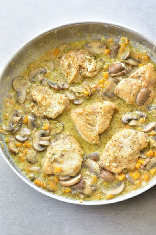 chicken in creamy butternut squash and mushroom sauce in a pan
