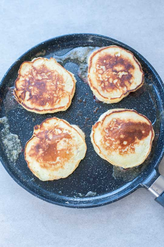 cooked lemon ricotta pancakes in a pan
