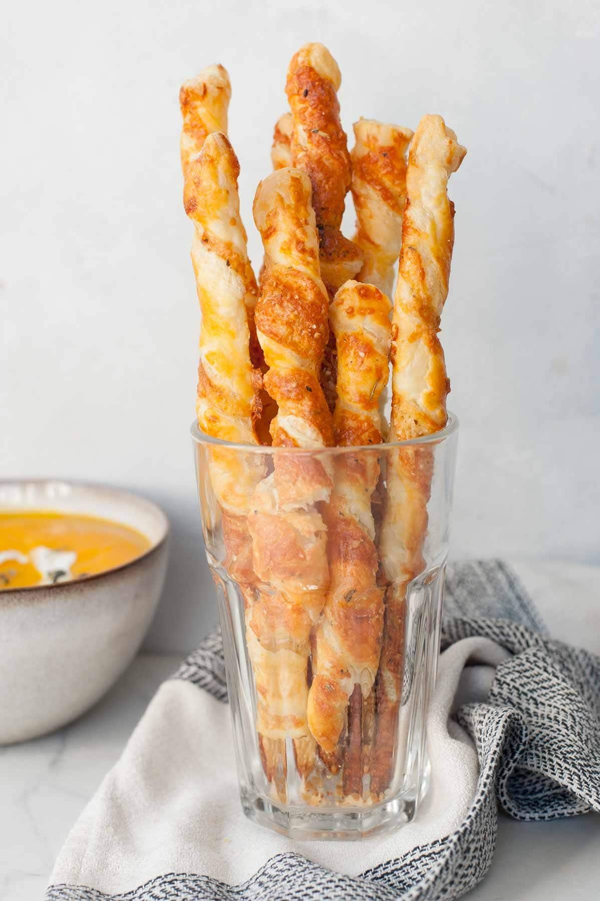 Puff pastry cheese straws in a glass