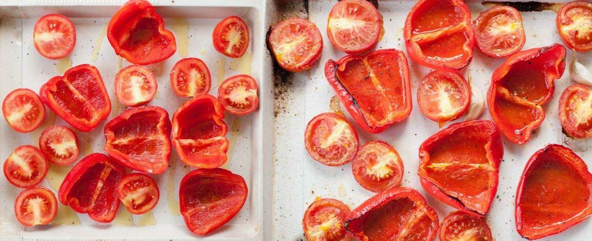 roasted tomatoes and bell paprika on a white sheet pan