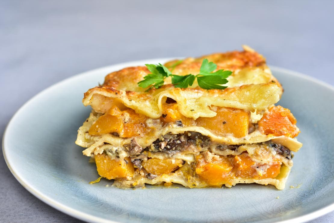 a piece of White Lasagna with pumpkin and mushrooms on a plate