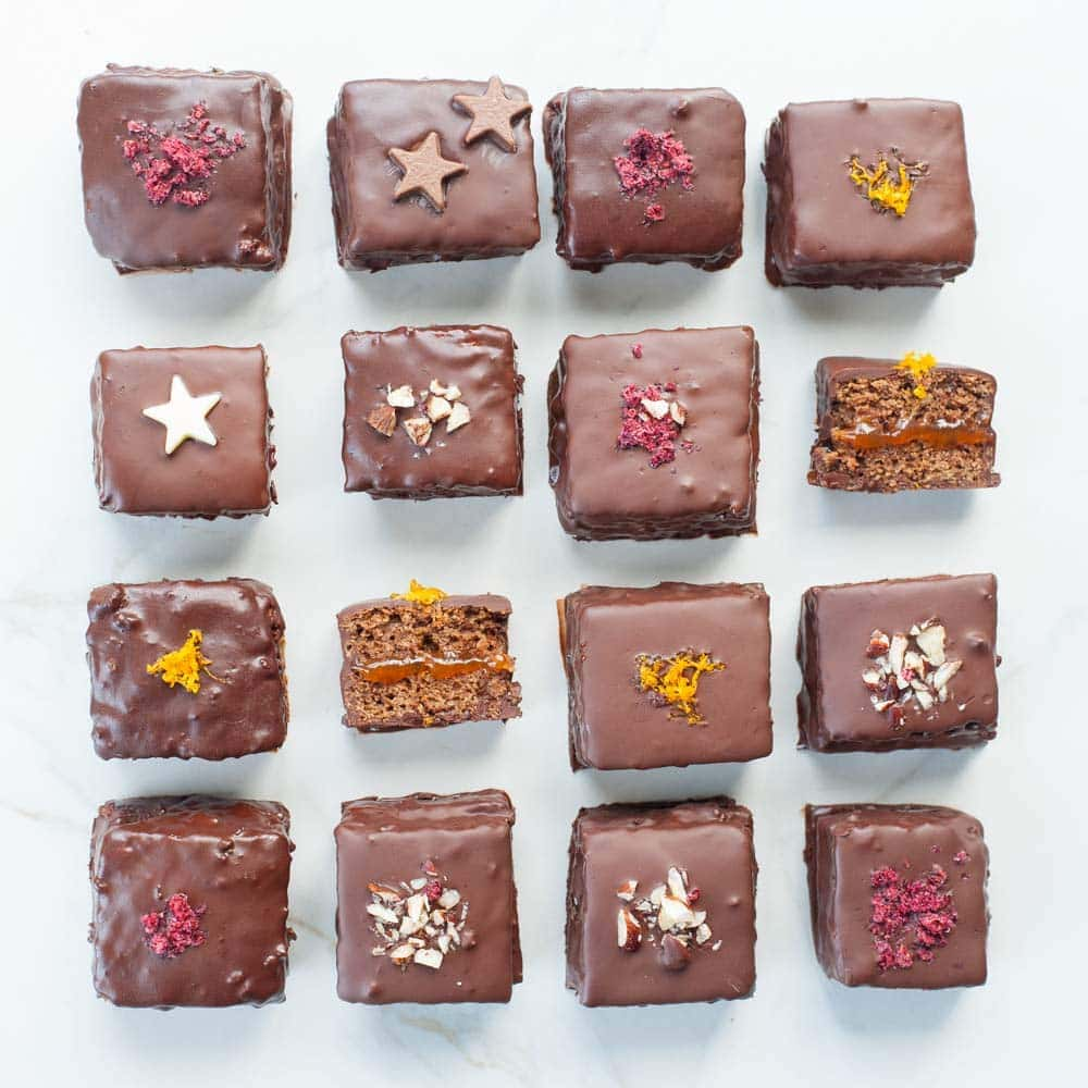 overhead shot on gingerbread squares with plum jam and chocolate (Lebkuchen cookies)