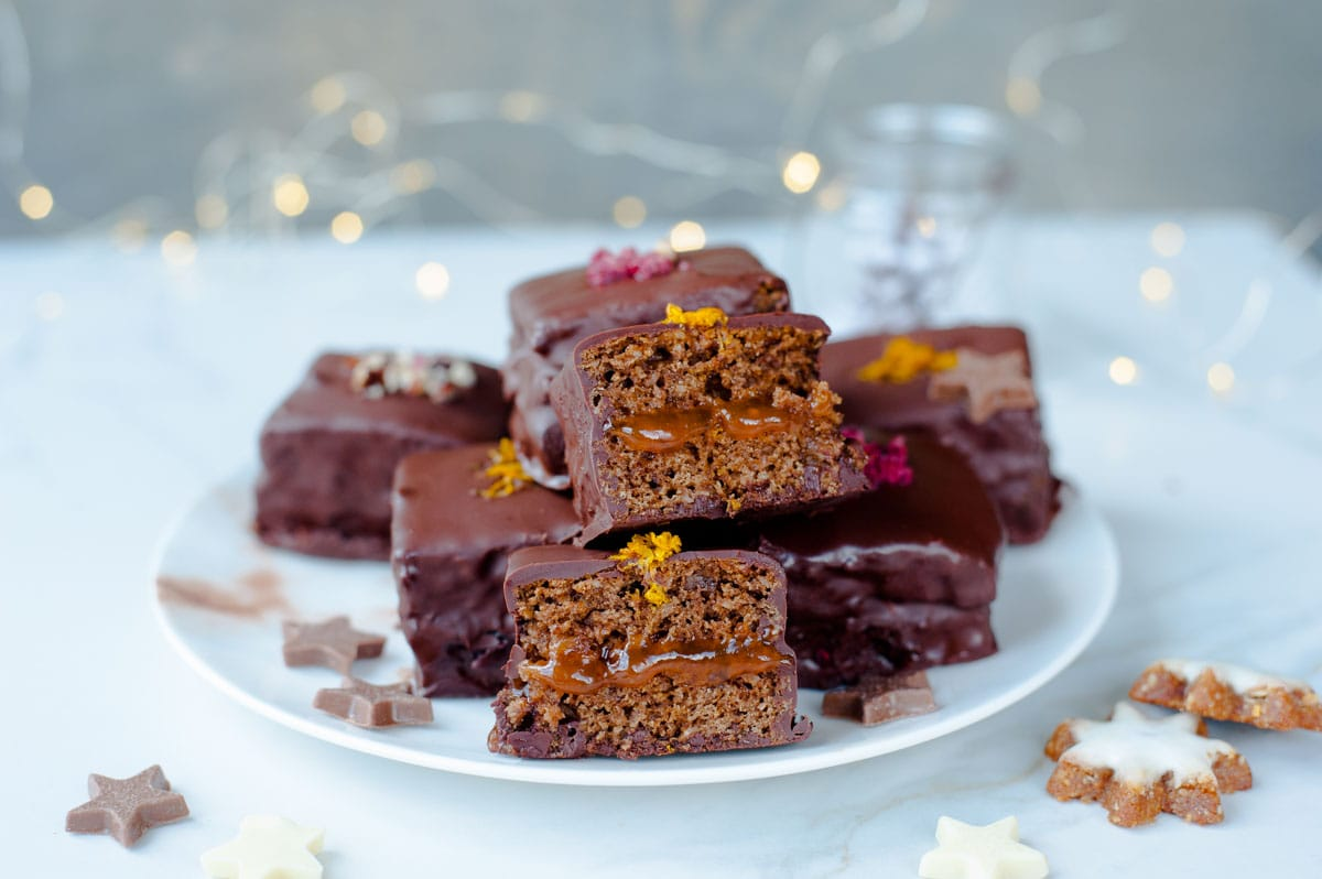 Gingerbread squares with plum jam and chocolate (Lebkuchen cookies) on a plate