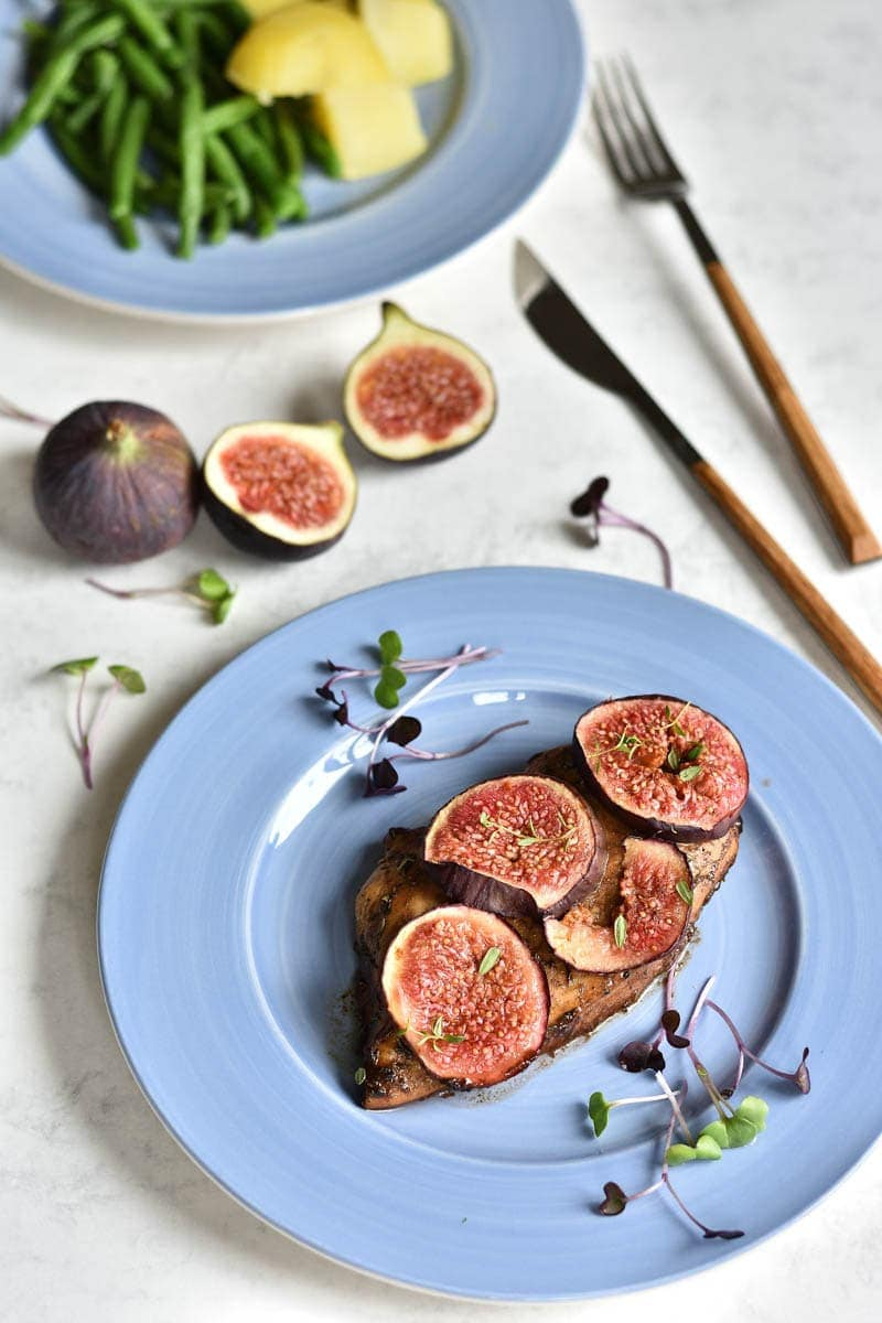 balsamic chicken with figs on a blue plate