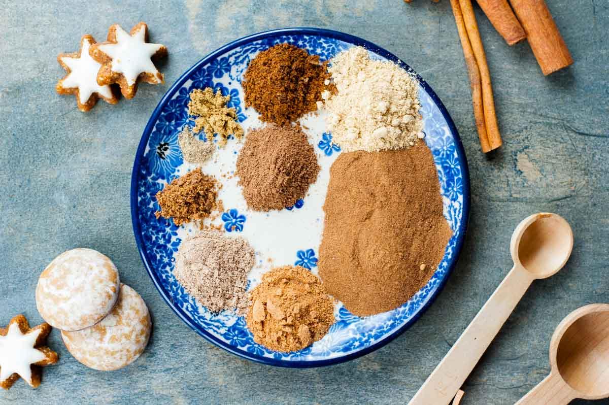 spices for gingerbread spice mix on a blue plate