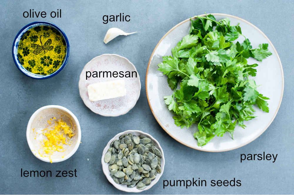 Ingredients needed to prepare parsley pesto.