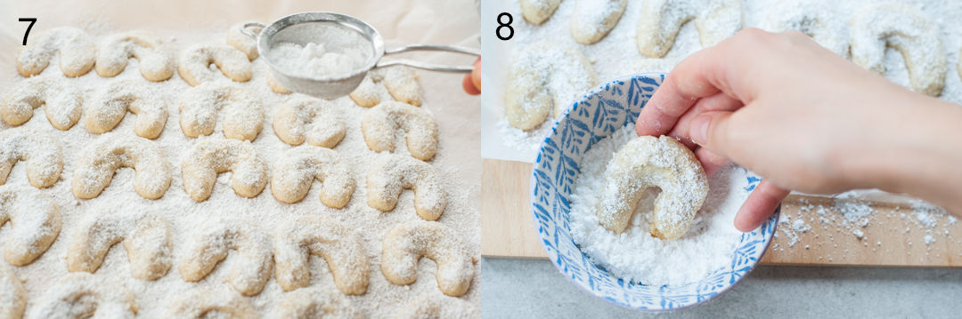 Vanillekipferl cookies are being dusted with powdered sugar.