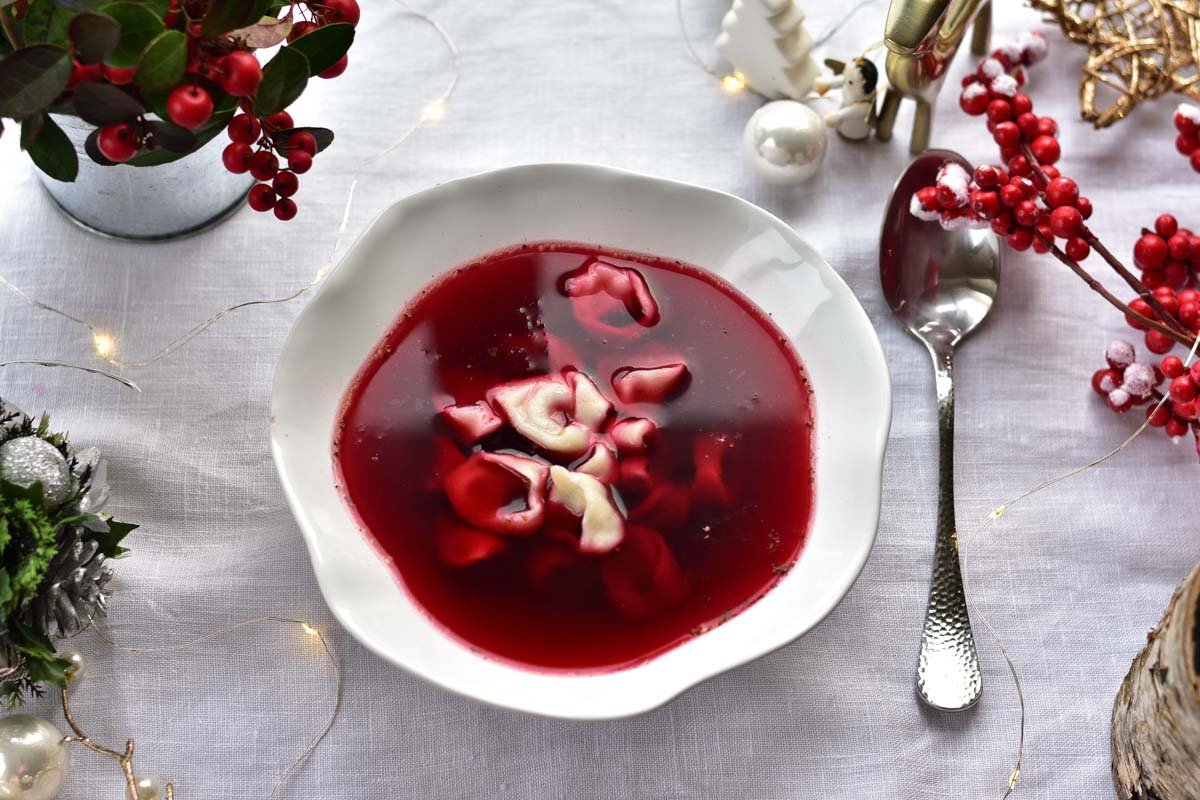Polish Christmas Eve Beet Soup Recipe on a table surrounded with Christmas decorations