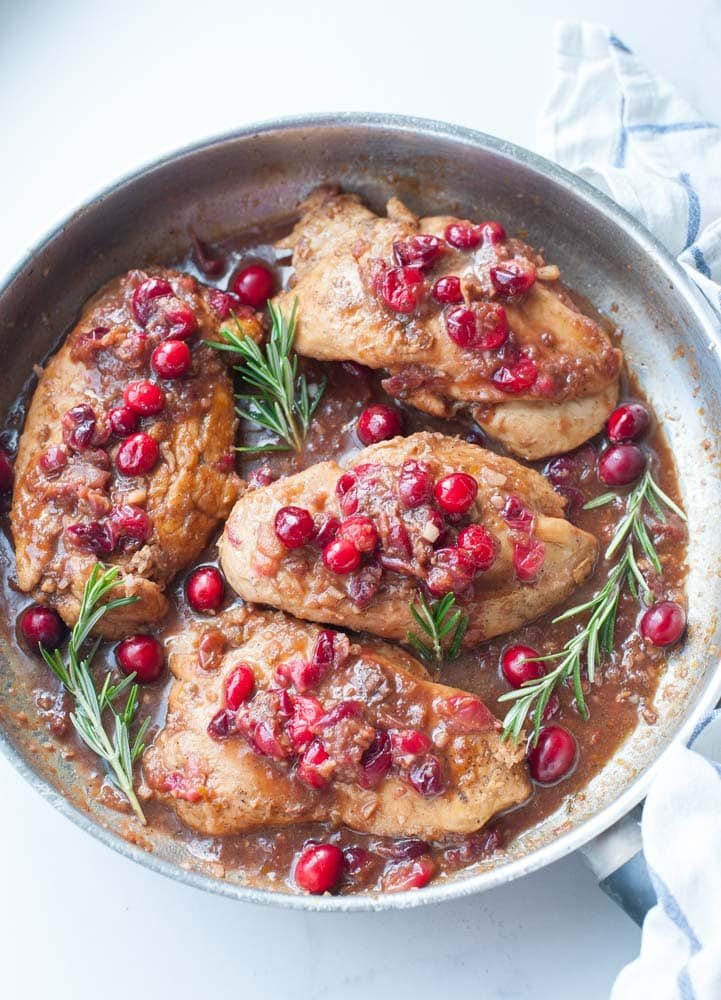 Cranberry balsamic chicken in a frying pan