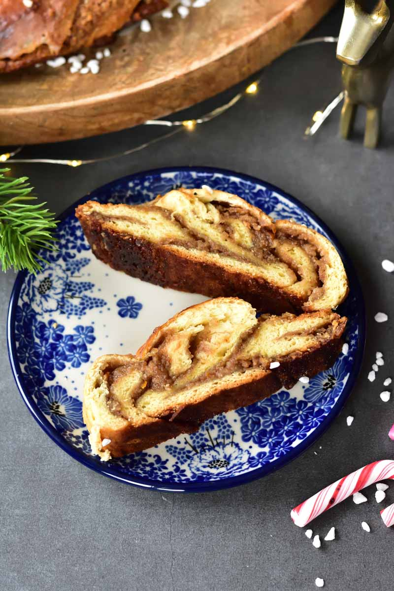 two servings of nut roll with chocolate (babka wreath) on a blue plate