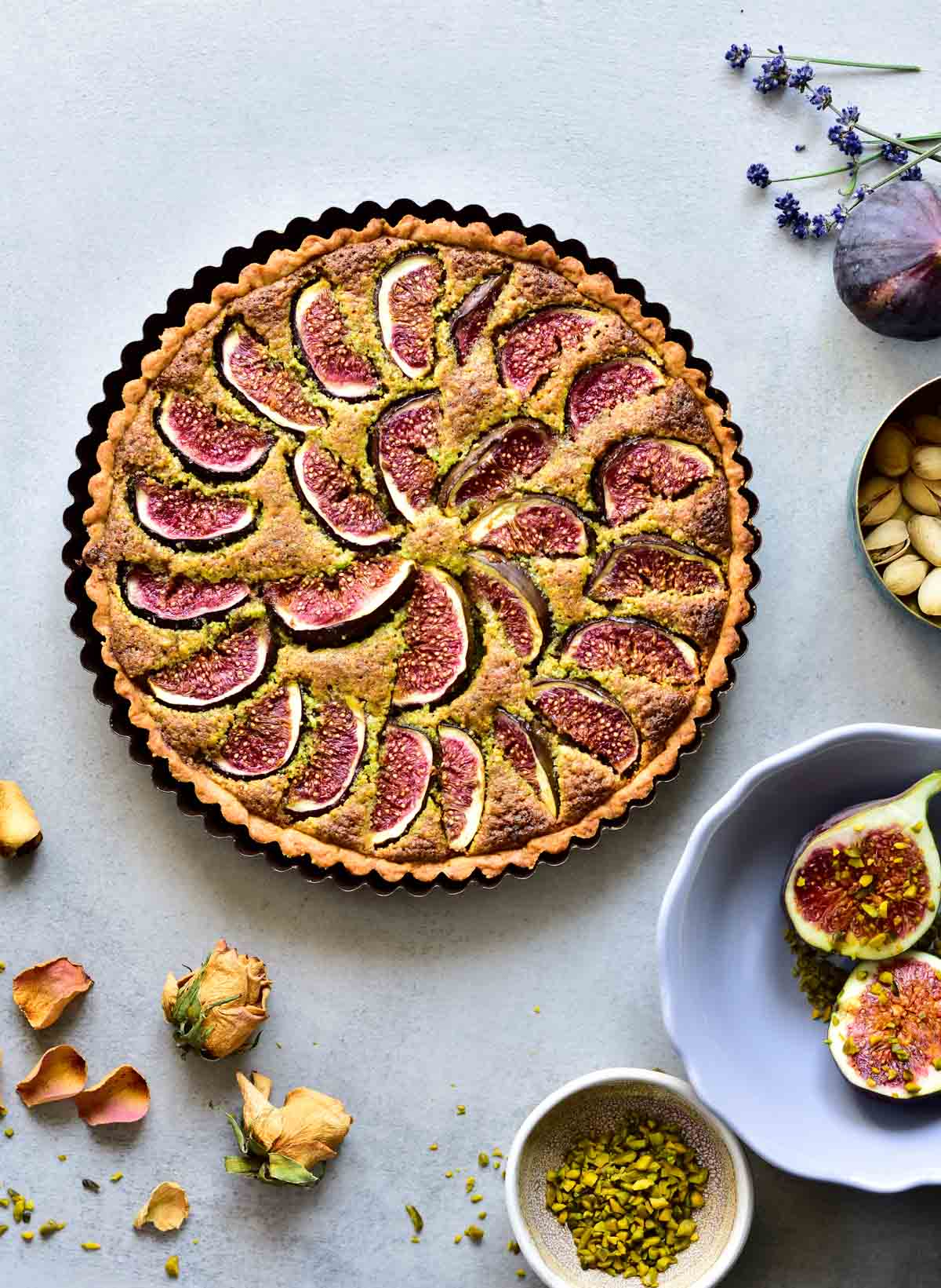 Fig tart with pistachio frangipane, figs and pistachios on the side