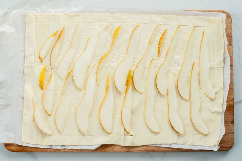 pear slices on a sheet of puff pastry