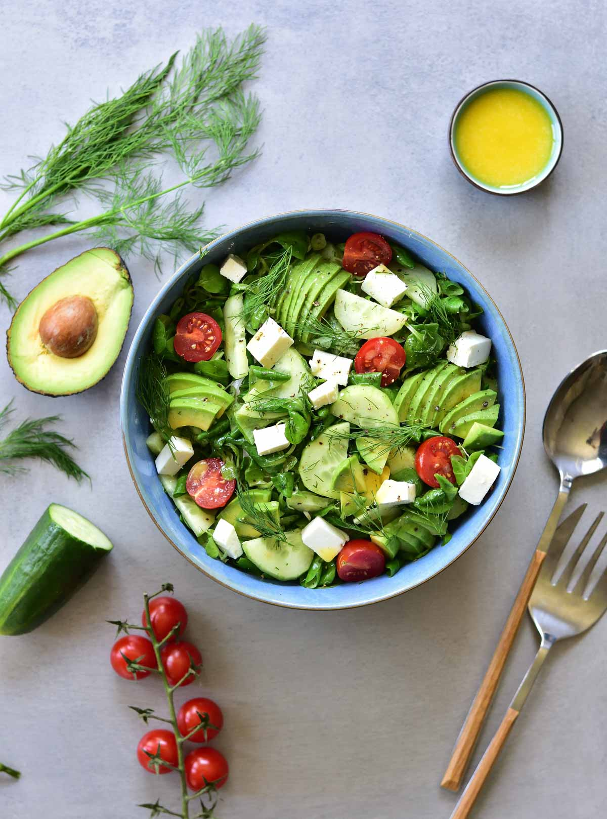 Cucumber avocado tomato salad with dill and feta
