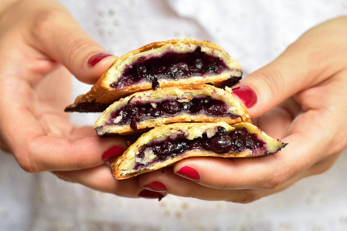 blueberry hand pies held in hands