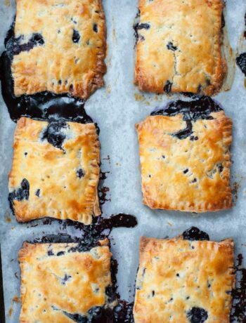 blueberry hand pies on a baking tray