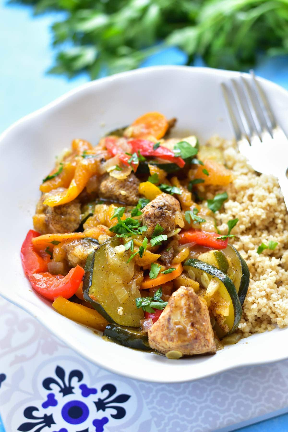 moroccan chicken with apricots and vegetables in a whitle bowl