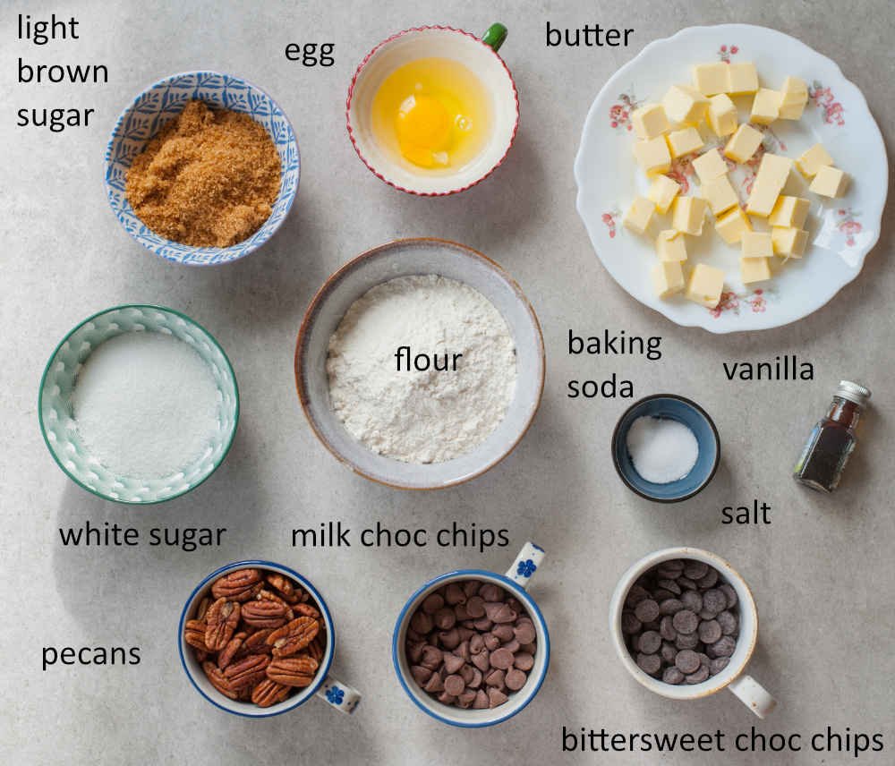 Ingredients needed to prepare chocolate chip pecan cookies.