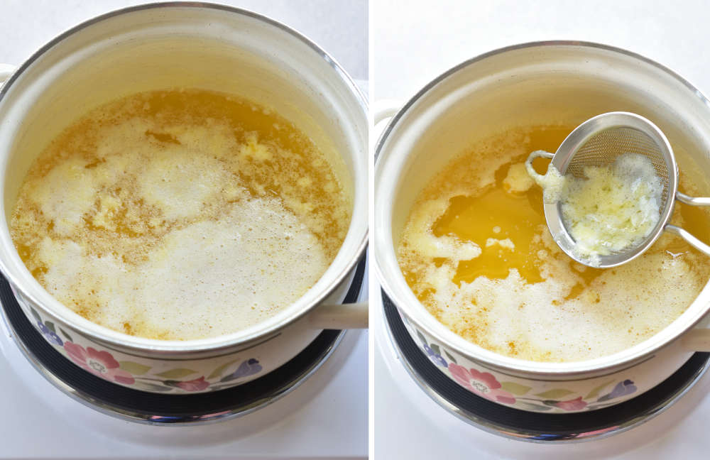Milk solid on the surface of clarified butter are being scooped with a small sieve.