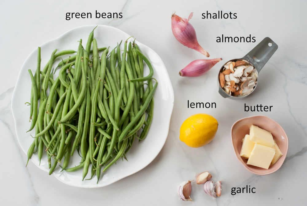 labeled ingredients needed to prepare green beans almondine
